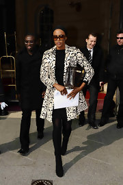 Naomi Campbell looked chic in Paris wearing a pair of black suede ankle boots.