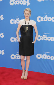 Emma Stone kept her look simple and edgy with a black dress with a satin bodice paired with a simple ivory top.