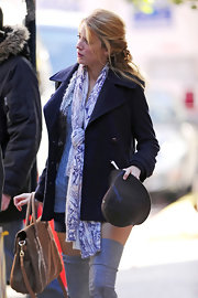 Blake Lively accessorized with thigh-high socks and a print scarf on the set of 'Gossip Girl.'