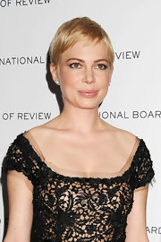 Michelle Williams looked fresh faced and natural in pale lip gloss.