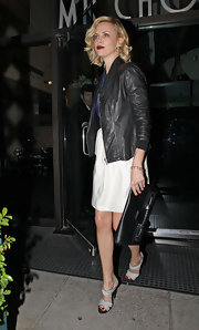 Charlize Theron accessorized her urban sophisticate style with a black leather clutch.