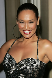 Tia Carrere contrasted her neutral outfit with deep red lips at the Night of 100 Stars party.