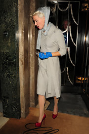 Daphne Guinness donned crimson platforms with a ladylike nude coat. The patent heels offered the perfect pop of color to her look.