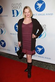 Ashley dons a burgundy sweater dress under a casual cardigan on the red carpet.