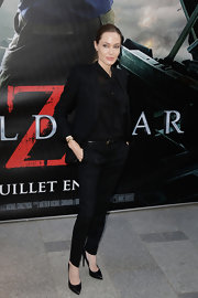Angelina Jolie stuck to her signature classic style with a touch of edge when she sported this all-black wool suit.