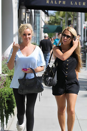 "Playboy bunny Bridget Marquardt made her way around Beverly Hills in a comfy outfit and loose bun while toting around the coveted ""City Bag""."