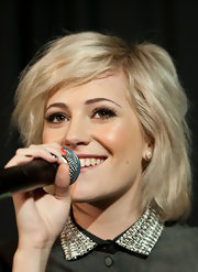 Pixie Lott wore her adorable layered bob slightly tousled while performing at a high school in Glasgow.