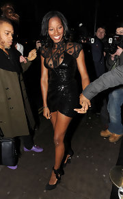 Jamelia shimmers in a provocative mini dress with a lace neckline.