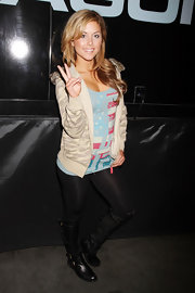 Brittney Palmer stepped out in a camouflage patterned zip-up hoodie at the 2012 MAGIC Convention.