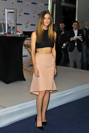 Brooklyn Decker dressed up a black crop top by pairing it with a knee-length blush skirt.
