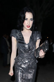 Dita Von Teese headed home from a party in Beverly Hills looking the picture of glamour. Her makeup and hair perfectly intact even after a long night of socialzing.