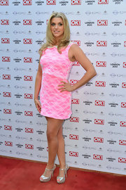 Anna Williamson wore a fun and flirty mini dress in a hot pink hue.