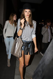 Alessandra tossed on this charming hat for an outing in West Hollywood.