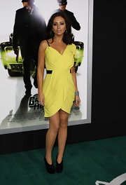 Nicole was a neon dream in a sunshine yellow cocktail dress with black accents.