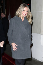Cameron stays warm in a chic charcoal wool coat.
