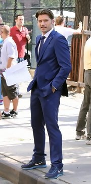 Nikolaj Coster-Waldau chose a bright blue two-button suit and matching tie for his look while on set.