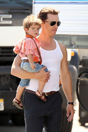The actor wore classic gold aviators while toting his adorable son on the set of his upcoming film.