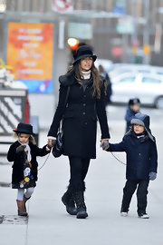 Camila Alves opted for a navy wool coat with fur shoulders for a classic and glamorous winter look.
