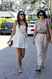 Camilla Belle completed her breezy look with black thong sandals by Tory Burch.
