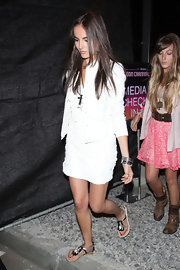 Camilla Belle attended the Coachella Music Festival wearing a pair of strappy flat sandals.