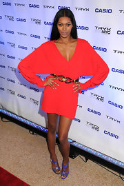 Jessica White was red hot in a dolmen sleeved red cocktail dress for the launch of the Casio Tryx digital camera. Jessica added a pop of color to her look with purple evening sandals.
