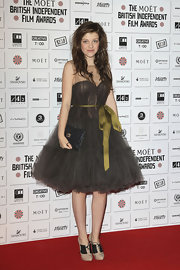 Georgie Henley paired her Lanvin for H&M frock with au courant nude high-heeled oxfords.