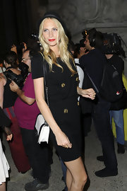 Poppy Delevigne embraced the two-tone trend with a chic black-and-white flap bag with a silver chain strap.