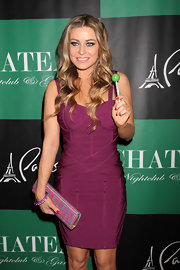 Carmen Electra polished her nails with a bright blazing red nail lacquer at the Chateau Nightclub in Las Vegas.