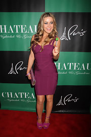 Carmen Electra wore this cranberry bandage dress to the St. Patrick's Day celebration in Vegas.