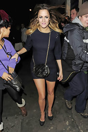 Caroline Flack wears a crips navy sheath dress with 3/4 length sleeves while leaving the 'X Factor' party.
