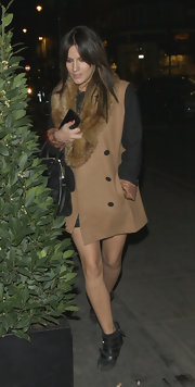 Caroline Flack kept even her outwear stylish with this two-toned wool coat with fur trim.