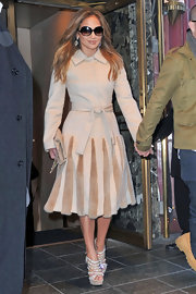 J. Lo topped off her fur-detailed coat with bold platform sandals.