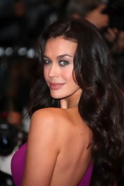 Megan Gale hit the red carpet at the 'Therese Desqueyroux' screening wearing her hair styled in long glossy waves.