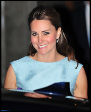 Kate Middleton chose this half up, half down 'do to pull back her lovely brown locks and show off her glowing face.
