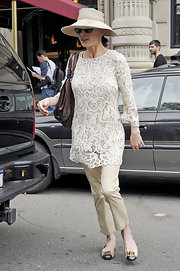 Catherine topped off her neutral look with a wide-brimmed straw hat.