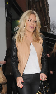 Mollie King rocked a two-toned leather biker jacket with zipper embellishments.