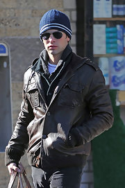 Chace paired his leather jacket with a navy blue knit beanie.