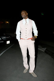 Chad Ochocinco pulled off a pale pink suit with aplomb. He paired the statement making color with a coral belt and gray suede shoes.