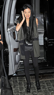 Vera Wang accented her skinny pants with a long multi-textured olive and black vest.