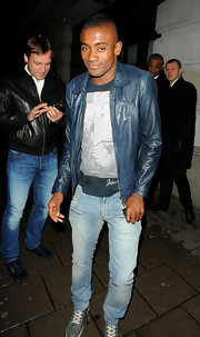 Washed-out, ripped blue jeans completed Salomon's dressed-down look as he celebrated his team's FA Cup win.