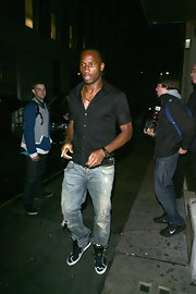 Dider Drogba stepped out in style wearing a classic leather band watch.