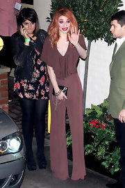 Nicola revives the 70's in this soft rust knit jumpsuit.
