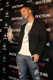 Mike wears a black blazer over his vest for the Doctrine clothing launch.