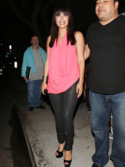 Cheryl paired this draped pink blouse with leather pants for  glammed-up look while out in Hollywood.