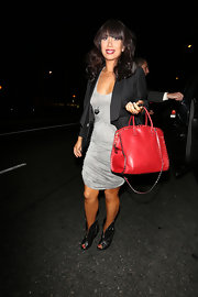 Cheryl Burke chose a red leather tote with studded detailing to add a splash of color to her look while out in Hollywood.