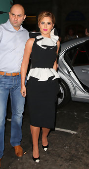 Cheryl continued on the black and white trend by pairing her black and white ruffled frock with matching cap toe shoes.