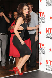 Cheryl Cole injected a splash of color into her NTA look with red satin Big Lips pumps with formidable metal spike heels.