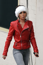 Cheryl Cole is a grouchy Santa in this red leather jacket and fur headband.