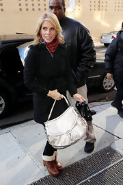 Cheryl Hines made her way to the 'Wendy Williams' show carrying a luxe ivory top handle purse.