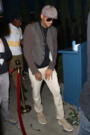 Chris Brown was seen wearing a pair of tan lace-up oxfords as he left Hooray Henry's for the night.